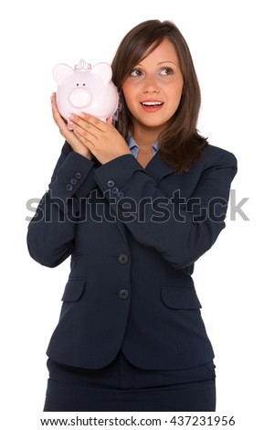 Businesswoman holding pink pig money-box - Piggy Bank. Isolated on white background. Looking away
