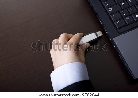businesswoman holding portable storage pen device - stock photo