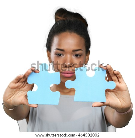 Businesswoman holding puzzle pieces