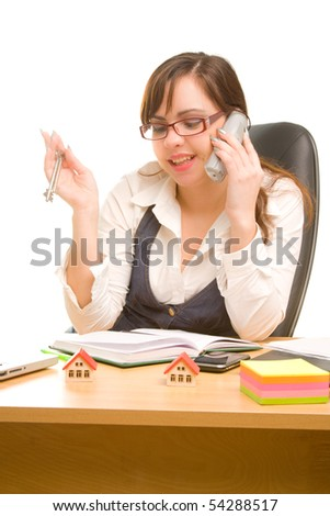 Businesswoman holding telephone and keys in her hands - stock photo