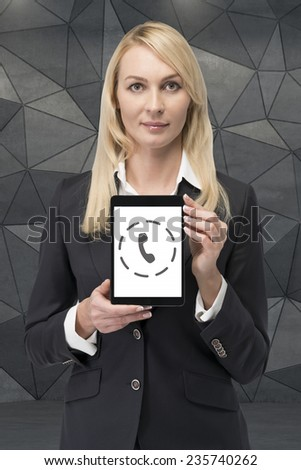 businesswoman holding touch pad with support button - stock photo