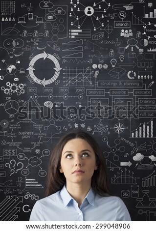 Businesswoman idea concept on blackboard - stock photo