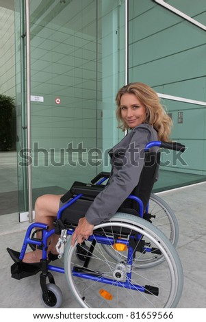 Businesswoman in a wheelchair - stock photo