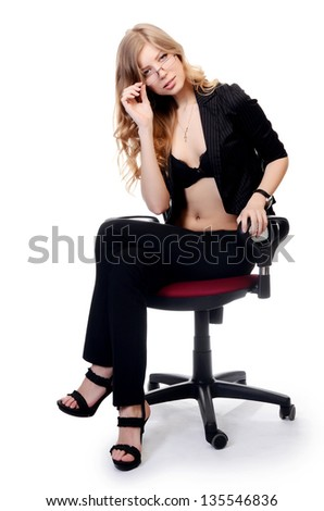Businesswoman  in an armchair isolated on white - stock photo