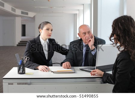Businesswoman in an interview with two business people - stock photo