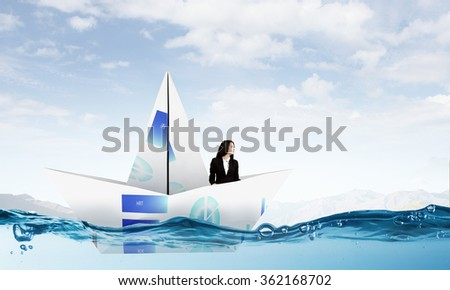 Businesswoman in boat made of paper - stock photo