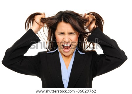 Businesswoman in formal suit tearing her hair out in despair. isolated on white - stock photo