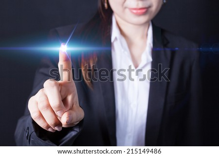 Businesswoman in front of visual touch screen