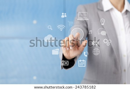 Businesswoman in front of visual touch screen.