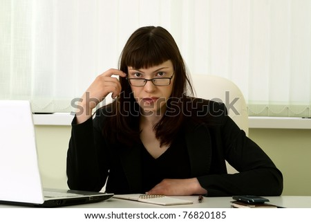 Businesswoman in glasses in her office
