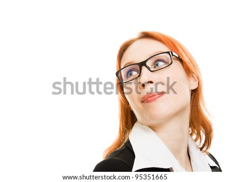 Businesswoman in glasses with the red hair looks away on a white background.