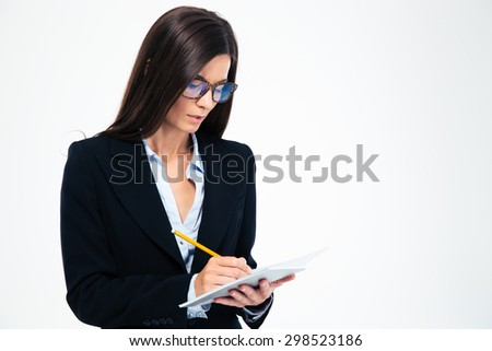 Businesswoman in glasses writing notes in notebook isolated on a white background - stock photo
