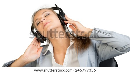 Businesswoman in headset sitting on chair with her hands on headset speakers, her head tilted sideways, eyes closed. Isolated over white background
