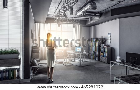 Businesswoman in modern office interior . Mixed media