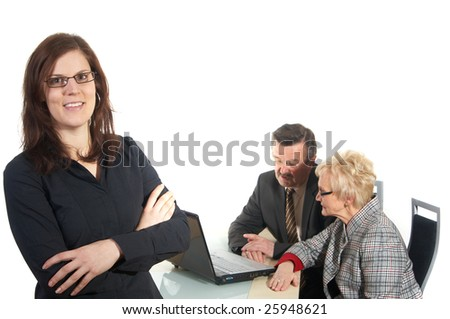 Businesswoman in office environment. Three people with focus on young woman in front. Isolated over white. - stock photo