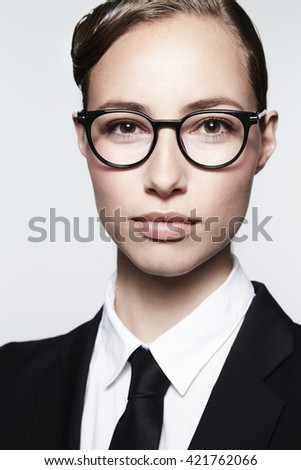 Businesswoman in spectacles, portrait - stock photo