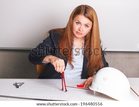 Businesswoman in suit drawing - stock photo