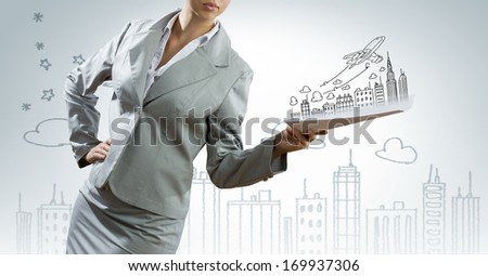 Businesswoman in suit holding documents in hands. Paperwork
