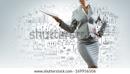Businesswoman in suit holding documents in hands. Paperwork - stock photo