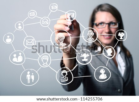 Businesswoman in suit pressing social media icon - stock photo