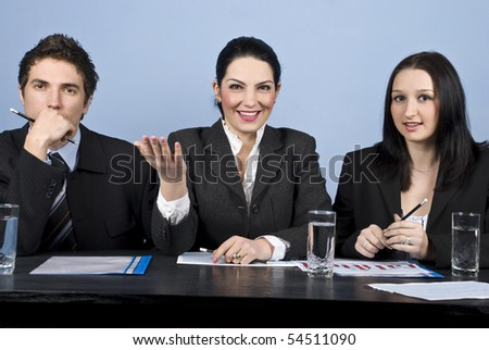 Businesswoman in the middle are expression her vision and talk about strategy at the conference and two other businesspeople listened her and looking you - stock photo