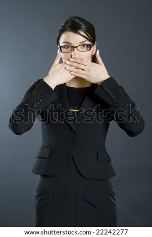 businesswoman in the Speak No Evil pose - stock photo