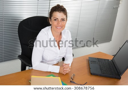 Businesswoman in white shirt working in the office