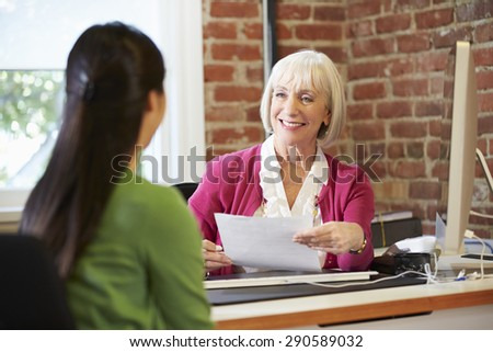 Businesswoman Interviewing Female Job Applicant In Office - stock photo