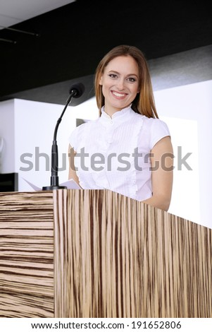Businesswoman is making speech at conference room - stock photo