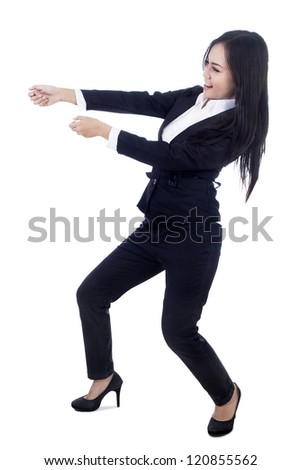 Businesswoman is pulling something on copy space - stock photo