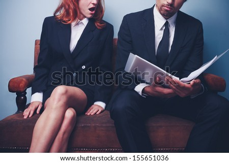 Businesswoman is shocked after reading document - stock photo