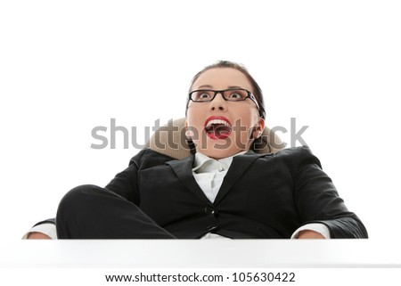 Businesswoman is sitting with happy, surprised face and looking up. Isolated on the white background. - stock photo