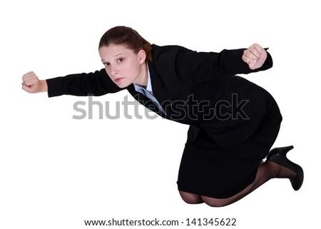 Businesswoman kneeling on the floor - stock photo