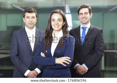 Businesswoman leader on the foreground of his team - stock photo