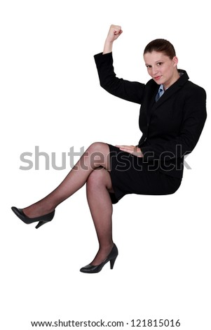businesswoman lifting arm to show strength - stock photo