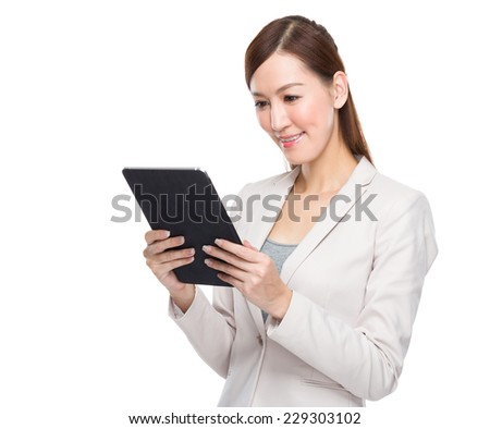 Businesswoman look at tablet