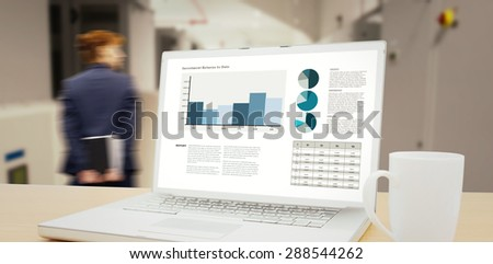 Businesswoman looking against data center - stock photo