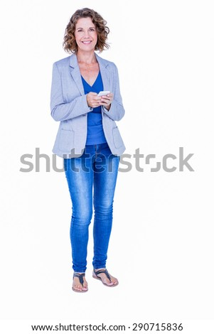 Businesswoman looking at camera and using her smartphone on white background - stock photo