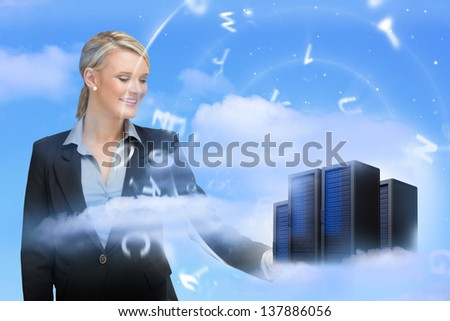 Businesswoman looking at data servers in blue sky with floating letters