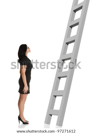 Businesswoman looking at ladder. Isolated on white background. - stock photo