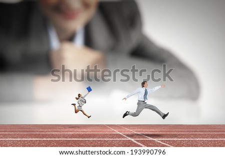 Businesswoman looking at miniatures of running business people - stock photo