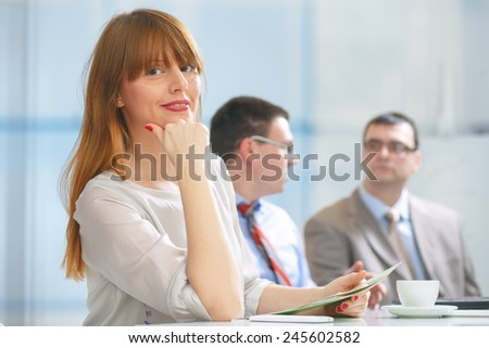 Businesswoman looking at the camera. - stock photo