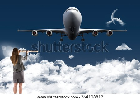 Businesswoman looking through a telescope against night sky - stock photo