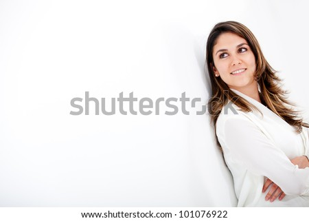Businesswoman looking to the side over a white background - stock photo