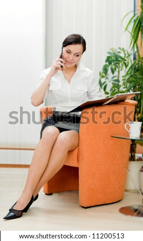 businesswoman making call at office
