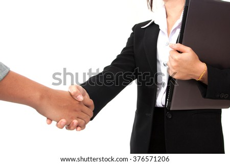 businesswoman making handshake with a businessman