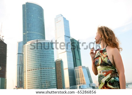 Businesswoman near modern buildings (moscow) - stock photo