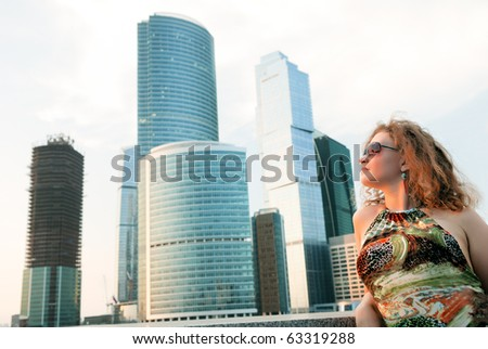 Businesswoman near modern buildings (moscow, russia) - stock photo