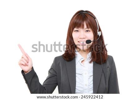 businesswoman of call center presenting and showing something - stock photo