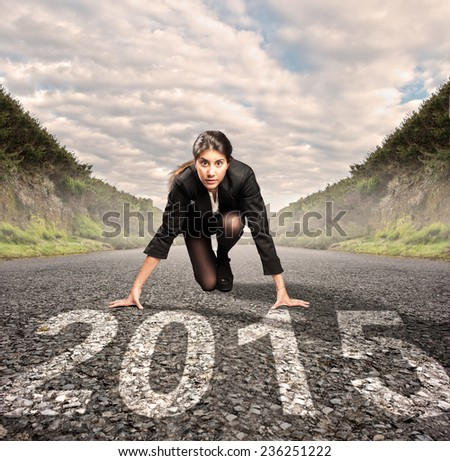 businesswoman on a road ready to run - stock photo